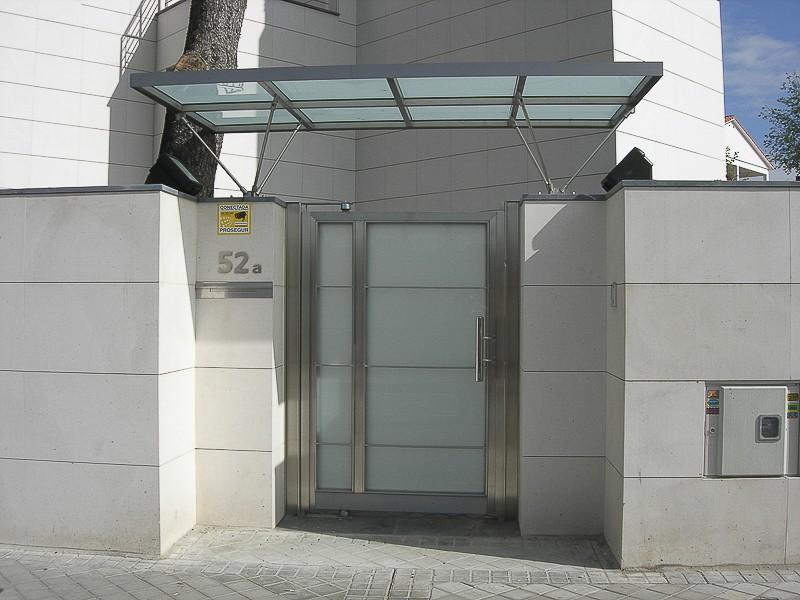 puertas acero comunidades madrid