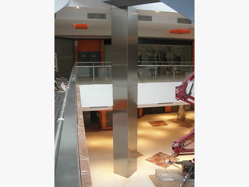 forrar pilares acero centros comerciales madrid